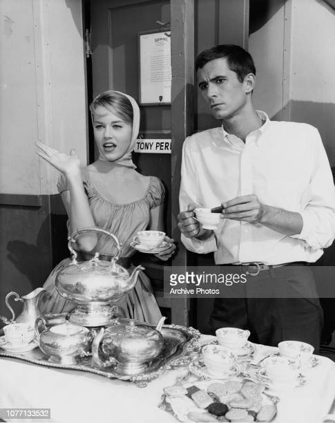 Costars Jane Fonda and Anthony Perkins take coffee on the set of the Warner Bros comedy 'Tall Story' circa 1960