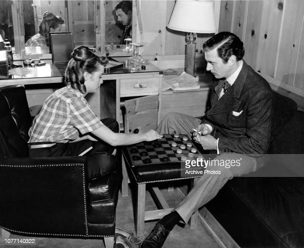 Costars Janet Leigh and Walter Pidgeon playing checkers on the set of the MGM film 'That Forsyte Woman' based on the first book of John Galsworthy's...