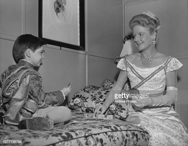 Costars Tommy Rettig and Ann Harding playing canasta on the set of the MGM film 'The Tender Hours' aka 'Two Weeks with Love' 1950 They are in costume...