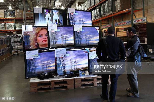 Costco customers look at a display of LCD HDTV televisions November 18 2009 in San Francisco California The California Energy Commission voted...