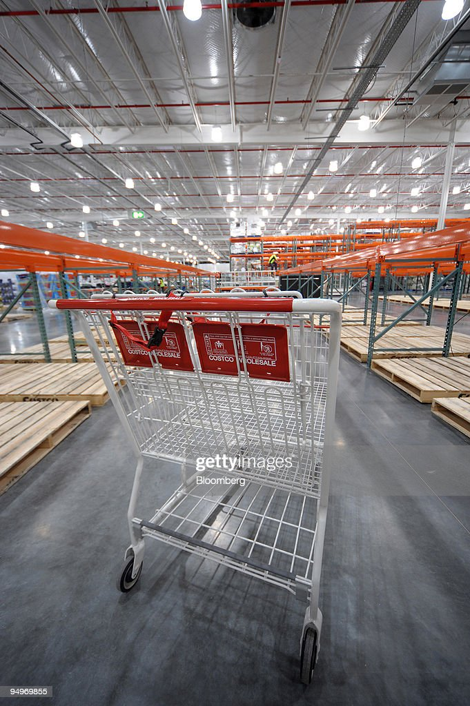 a costco wholesale corp shopping cart stands in an empty aisle as news photo getty images. Black Bedroom Furniture Sets. Home Design Ideas