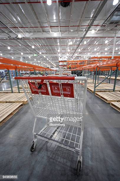 Costco Wholesale Corp shopping cart stands in an empty aisle as the new Costco warehouse is prepared prior to it's opening next month in Melbourne...