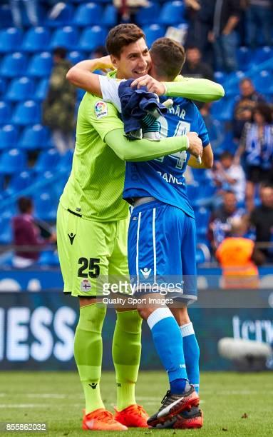 Costel Pantilimon of Deportivo de La Coruna celebrate the victory with Fabian Schar of Deportivo de La Coruna during the La Liga match between...