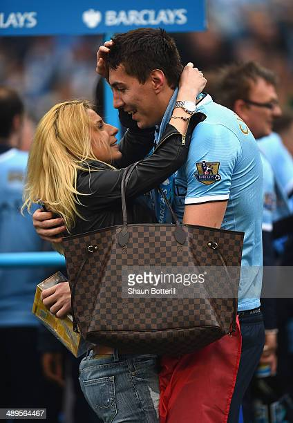 Costel Pantilimon of Manchester City is congratulated by his wife Andrea at the end of the Barclays Premier League match between Manchester City and...