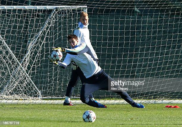 Costel Pantilimon of Manchester City makes a save as Joe Hart looks on during a training session at Carrington Training Ground on November 4 2013 in...