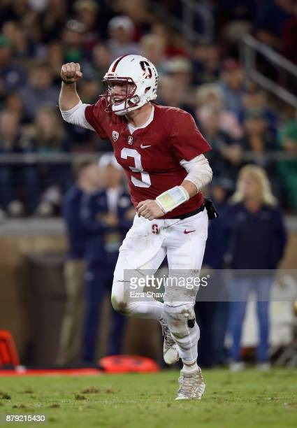 J Costello of the Stanford Cardinal celebrates after Cameron Scarlett of the Stanford Cardinal ran in for a touchdown against the Notre Dame Fighting...