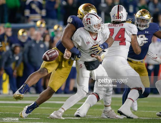 J Costello of the Stanford Cardinal is sacked by Jerry Tillery of the Notre Dame Fighting Irish during the game at Notre Dame Stadium on September 29...