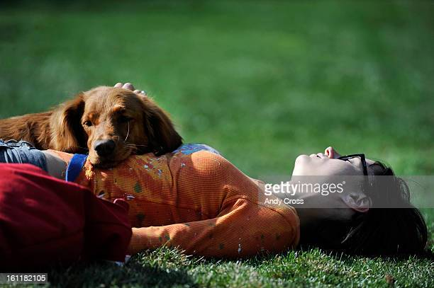 """Stephanie Sizemore, and her dog, """"Sasha,"""" take a break while waiting for the IFSC World Cup Bouldering semi-finals at the 10th annual Teva Mountain..."""