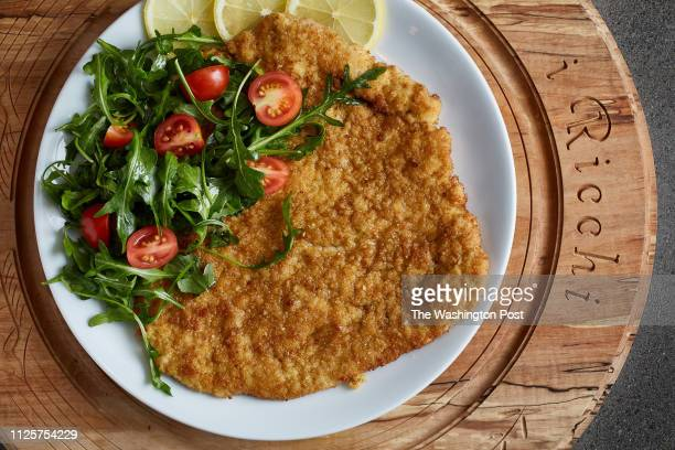 Costoletta alla Milanese Panfried Veal Chop Arugula and Plum Tomatoes photographed I Ricchi in Washington DC on February 1 2019