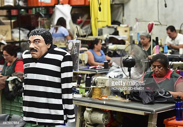 """Costume and a mask representing Mexican drug trafficker Joaquin Guzman Loera, aka """"El Chapo"""", are pictured in a factory of costumes and masks, on..."""