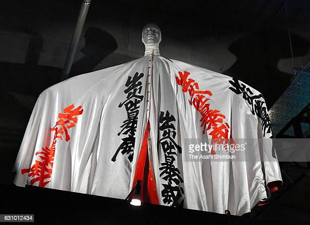 A costume created by designer Kansai Yamamoto for David Bowie is displayed during the press preview of the 'David Bowie is' exhibition at Warehouse...