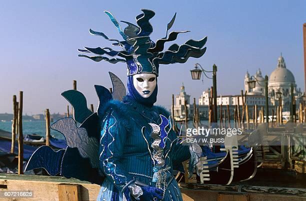 Costume depicting the sea Venice carnival gondolas in the background Veneto Italy