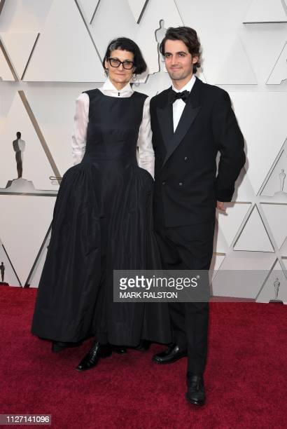 Costume designer Alexandra Byrne and guest arrive for the 91st Annual Academy Awards at the Dolby Theatre in Hollywood California on February 24 2019