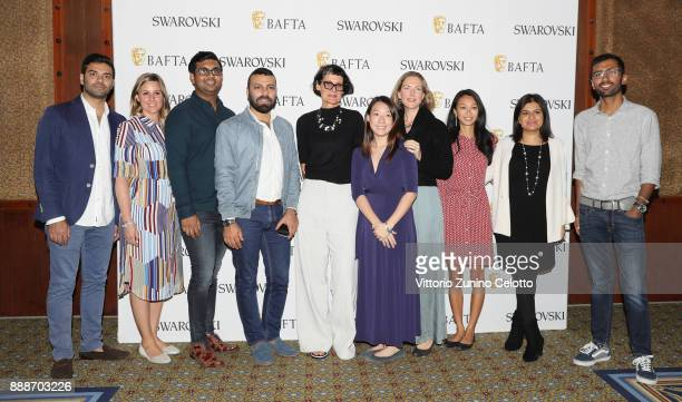 Costume designer Alexandra Byrne and guests pose after her Masterclass on day four of the 14th annual Dubai International Film Festival held at the...