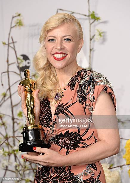 Costume designer Catherine Martin winner of Best Achievement in Costume Design poses in the press room during the Oscars at Loews Hollywood Hotel on...