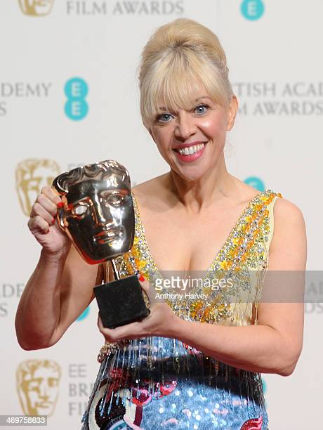 Costume Designer Catherine Martin winner of the Costume Design award poses in the winners room at the EE British Academy Film Awards 2014 at The...