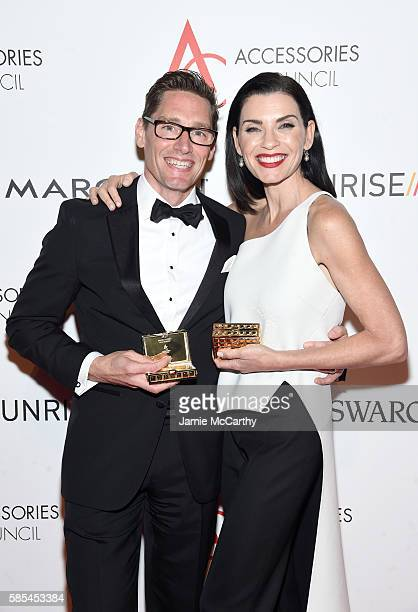 Costume designer Daniel Lawson and Actress Julianna Margulies poses with awards during the Accessories Council 20th Anniversary celebration of the...