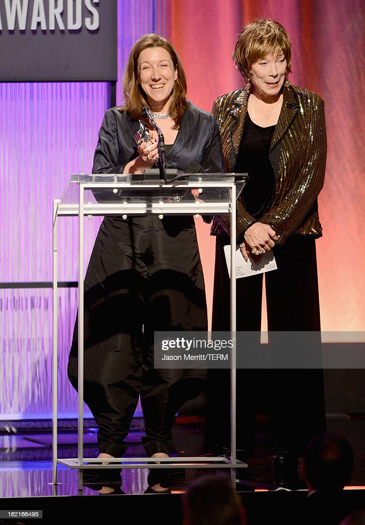 Costume designer Jacqueline Durran (L) accepts award for Excellence in a Period film for 'Anna Karenina' from presenter Shirley MacLaine onstage during the 15th Annual Costume Designers Guild Awards with presenting sponsor Lacoste at The Beverly Hilton Hotel on February 19, 2013 in Beverly Hills, California.