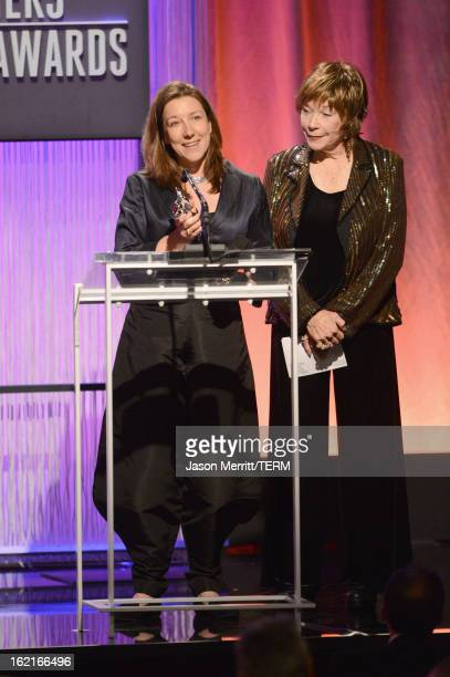 Costume designer Jacqueline Durran accepts award for Excellence in a Period film for 'Anna Karenina' from presenter Shirley MacLaine onstage during...