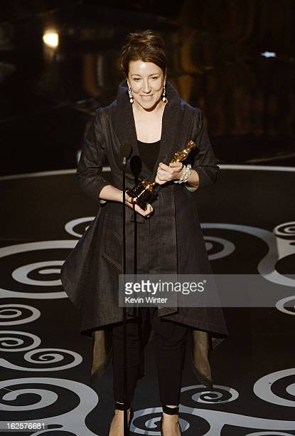 Costume designer Jacqueline Durran accepts the Best Costume Design award for Anna Karenina onstage during the Oscars held at the Dolby Theatre on...
