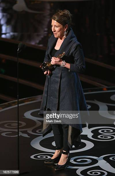 Costume designer Jacqueline Durran accepts the Best Costume Design award for 'Anna Karenina' onstage during the Oscars held at the Dolby Theatre on...