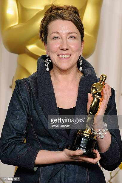 Costume designer Jacqueline Durran poses in the press room during the Oscars at the Loews Hollywood Hotel on February 24 2013 in Hollywood California