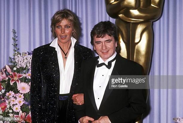 Costume designer James Acheson actress Bo Derek and actor Dudley Moore attend the 61st Annual Academy Awards on March 29 1989 at Shrine Auditorium in...