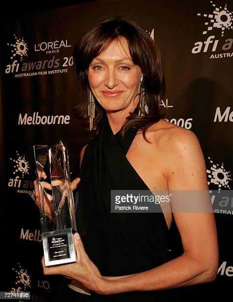 Costume Designer Jane Johnston poses in the awards room with the award for Best Costume Design at the L'Oreal Paris AFI 2006 Industry Awards at the...