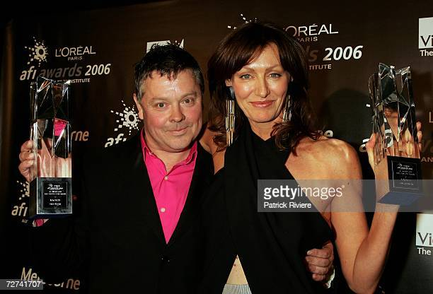 Costume Designer Jane Johnston poses in the awards room with the award for Best Costume Design with Production Designer David McKay who poses in with...