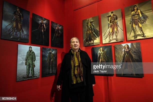 Costume designer Lindy Hemming poses in front of her costume designs is on display at the DC Comics Exhibition Dawn Of Super Heroes at the O2 Arena...