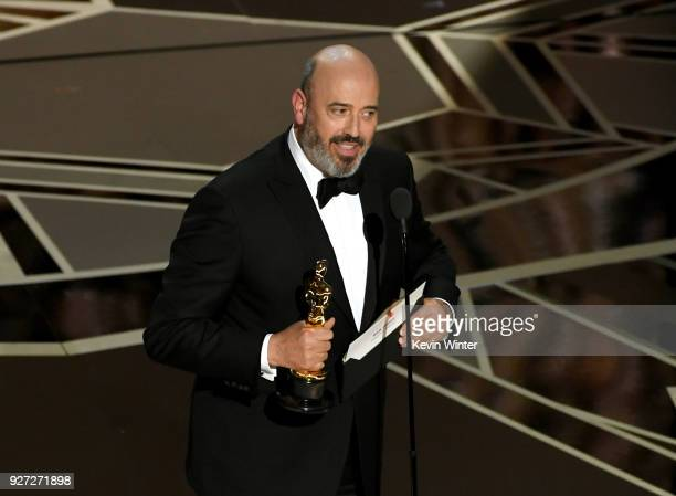 Costume designer Mark Bridges accepts Best Costume Design for 'Phantom Thread' onstage during the 90th Annual Academy Awards at the Dolby Theatre at...