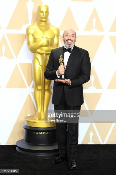 """Costume designer Mark Bridges winner of the Costume Design for """"Phantom Thread"""" poses in the press room during the 90th Annual Academy Awards at..."""
