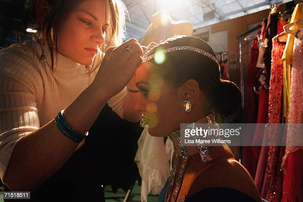 Costume designer Megan Stewart applies finishing touches to Lauren McFarlane at the 2006 FATD National Capital Dancesport Championships June 25 2006...