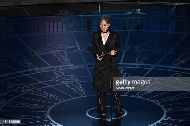 Costume designer Milena Canonero accepts the Best Costume Design Award for The Grand Budapest Hotel onstage during the 87th Annual Academy Awards at...
