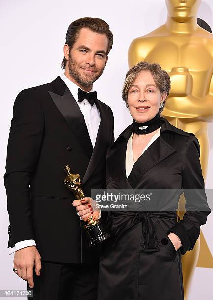 Costume designer Milena Canonero and actor Chris Pine pose in the press room during the 87th Annual Academy Awards at Loews Hollywood Hotel on...
