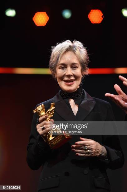 Costume designer Milena Canonero poses on stage with the Honorary Golden Bear at the 'The Shining Hommage Milena Canonero' premiere during the 67th...