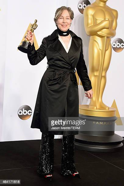 Costume designer Milena Canonero winner of the Best Costume Design Award for 'The Grand Budapest Hotel' poses in the press room during the 87th...