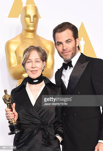 Costume designer Milena Canonero winner of the Best Costume Design Award for 'The Grand Budapest Hotel' and actor Chris Pine pose in the press room...