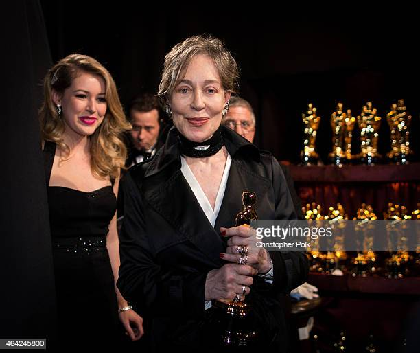 Costume designer Milena Canonero winner of the Best Costume Design Award for 'The Grand Budapest Hotel' poses backstage during the 87th Annual...
