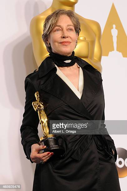 Costume designer Milena Canonero winner of the Best Costume Design Award for 'The Grand Budapest Hotel poses inside the press room of the 87th Annual...
