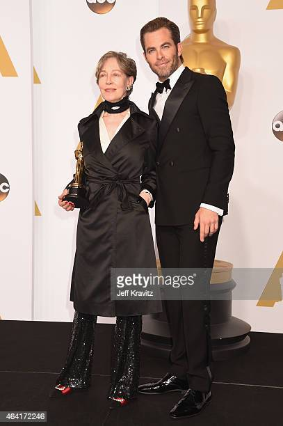 Costume Designer Milena Canonero with the award for best costume design for the film The Grand Budapest Hotel and actor Chris Pine pose in the press...