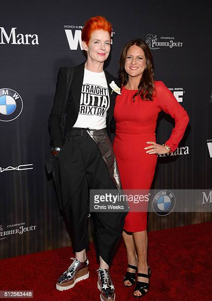 Costume designer Sandy Powell and president of Women In Film Los Angeles Cathy Schulman in Max Mara attend Ninth Annual Women In Film PreOscar...