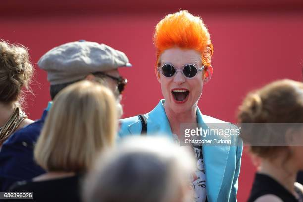 Costume designer Sandy Powell departs the 'How To Talk To Girls At Parties' premiere during the 70th annual Cannes Film Festival at Palais des...