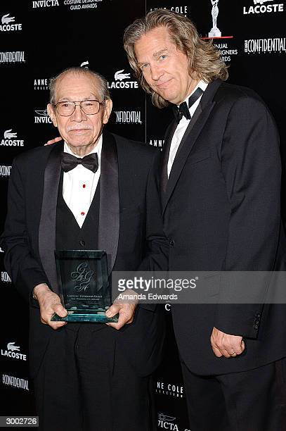 Costume Designer Tomas Velasco and Actor Jeff Bridges pose during the 6th Annual Costume Guild Awards on February 21 2004 in the International...