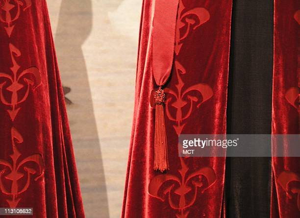Costume designer Trish Biggar incorporated symbols for Naboo the royal household and Padme in the Star Wars movies as shown in costumes displayed at...