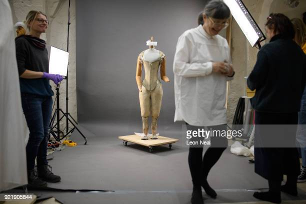 Costume historian Jenny Tiramani smiles after fitting a 'pair of straight bodies' to the funeral effigy of Elizabeth I at Westminster Abbey on...