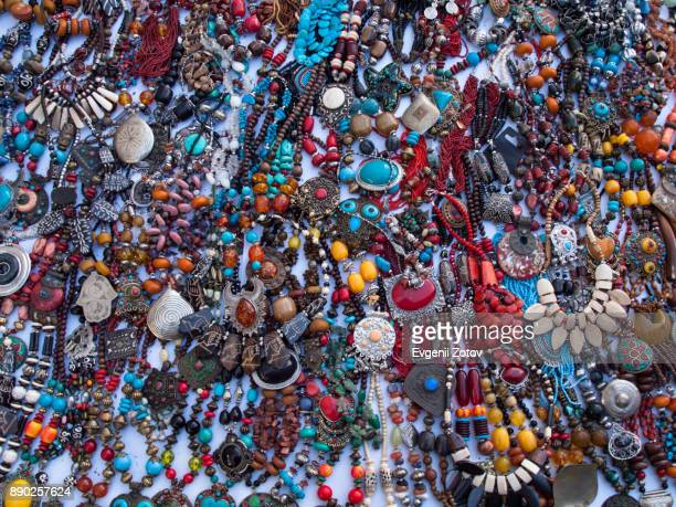 costume jewelry items for sale on flea market in casablanca, morocco - jewellery products stock photos and pictures