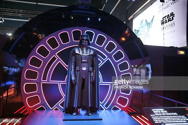 A costume of character Darth Vader from the Star Wars film series is displayed during the presentation of the exhibition Star Wars Identities at the...