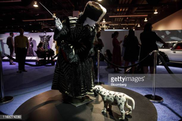 A costume of Cruella De Vil with a puppy characters from the film 101 Dalmatians are displayed during a media preview at the D23 Expo 2019 in Anaheim...