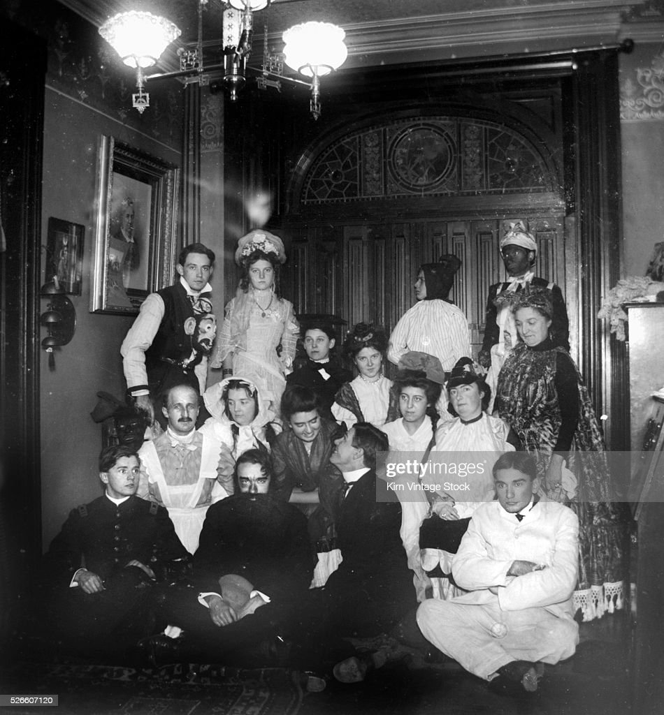 Costume party group portrait, ca. 1900. : News Photo